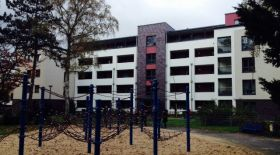 A housing block that also includes meeting space and a playground